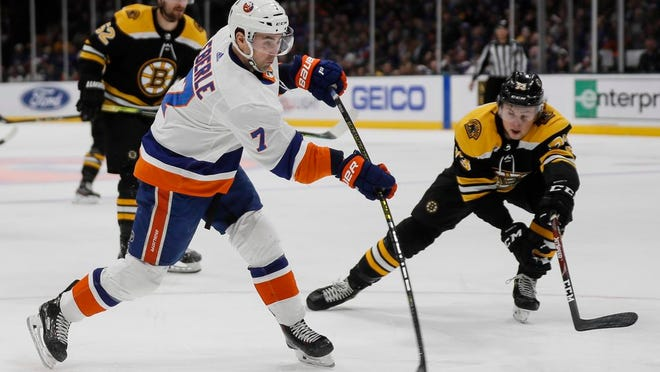 New York Islanders right wing Jordan Eberle (7) takes a shot on goal during the second period an NHL hockey game against the Boston Bruins, Saturday, Feb. 29, 2020, in Uniondale, NY.