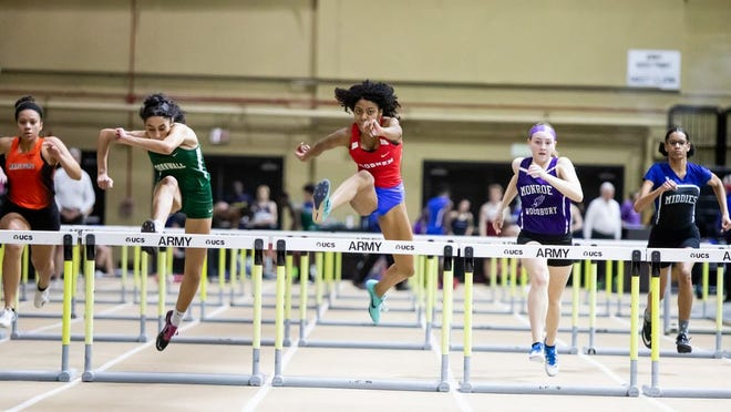 Goshen's Gwendolyn Logan, center wins the girls 55 meter hurdles prelims at the Section 9 track and field state qualifier at West Point, NY on February 28, 2020.  ALLYSE PULLIAM/For the Times-Herald Record