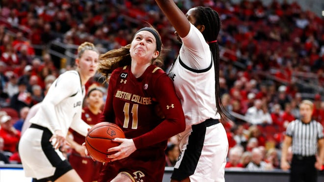 Boston College forward Emma Guy (11) drives for a shot as Louisville forward Elizabeth Dixon, right, defends during the first half of an NCAA college basketball game Thursday, Feb. 27, 2020, in Louisville, Ky.