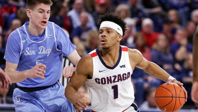 Gonzaga guard Admon Gilder, right, drives while pressured by San Diego guard Finn Sullivan during the second half of an NCAA college basketball game in Spokane, Wash., Thursday, Feb. 27, 2020. Gonzaga won 94-59.