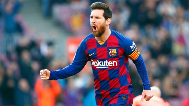 Barcelona's Lionel Messi celebrates after scoring his side's opening goal during a Spanish La Liga soccer match between Barcelona and Eibar at the Camp Nou stadium in Barcelona, Spain, Saturday Feb. 22, 2020.
