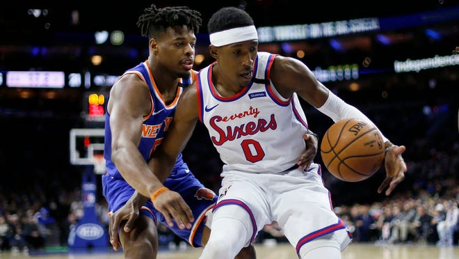 Philadelphia 76ers' Josh Richardson, right, steals the ball from New York Knicks' Dennis Smith Jr. during the first half of an NBA basketball game, Thursday, Feb. 27, 2020, in Philadelphia.
