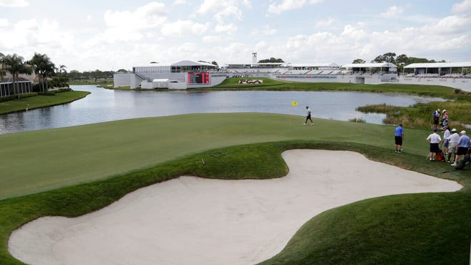 """Rickie Fowler walks on the 17th green during the Pro-Am of the Honda Classic golf tournament, Wednesday, Feb. 26, 2020, in Palm Beach Gardens, Fla. PGA National's signature test is a three-hole span on the back called """"The Bear Trap,"""" named for Jack Nicklaus and touted as one of the most demanding stretches in all of golf."""