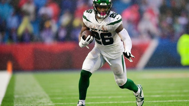 New York Jets running back Le'Veon Bell (26) during the first half of an NFL football game against the Buffalo Bills Sunday, Dec. 29, 2019 in Orchard Park, N.Y.