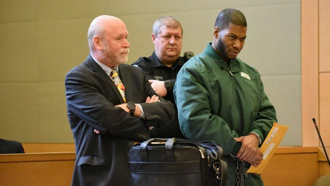 Kaliek Goode-Ford, right, charged with killing three family members in the Town of Newburgh, addresses Judge William DeProspo in Orange County Court on Tuesday while standing next to his lawyer, Randy Siper. Goode-Ford requested a new attorney be assigned to his case, which the judge denied.