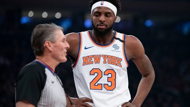New York Knicks center Mitchell Robinson (23) reacts to a call by referee Scott Foster in the first half of an NBA basketball game against the Indiana Pacers, Friday, Feb. 21, 2020, at Madison Square Garden in New York.