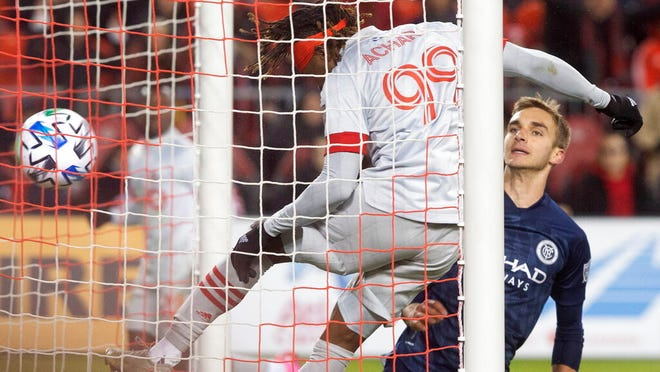 Toronto FC forward Ifunanyachi Achara (99) heads his team's game winning goal as New York City FC midfielder James Sands (16) looks on during the second half of an MLS soccer game in Toronto, Saturday March 7, 2020.