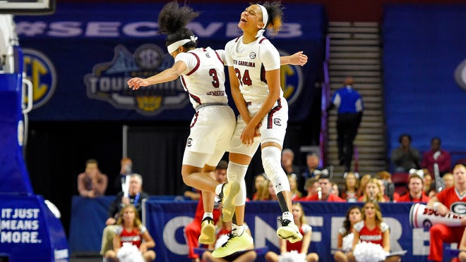 South Carolina's Destanni Henderson (3) and LeLe Grissett celebrate during the second half of a quarterfinal match against Georgia at the Southeastern women's NCAA college basketball tournament in Greenville, S.C., Friday, March 6, 2020.