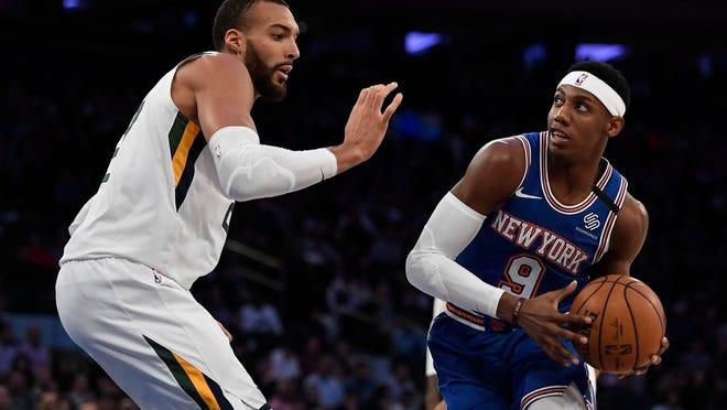Knicks guard RJ Barrett (9) dribbles the ball as Jazz center Rudy Gobert defends during the first half.