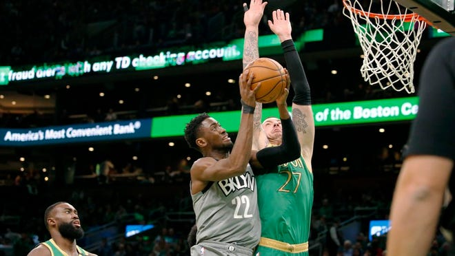 Brooklyn Nets guard Caris LeVert (22) drives to the basket against Boston Celtics' Daniel Theis during the first half of an NBA basketball game Tuesday, March 3, 2020, in Boston.