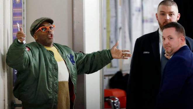 Director Spike Lee, left, gestures in a hallway on the event level at Madison Square Garden while arguing with security officers who didn't want to permit him to access his court side seat before the start of an NBA basketball game between the New York Knicks and the Houston Rockets in New York, Monday, March 2, 2020. Lee later spoke with Knicks owner James Dolan and security and was allowed to get to his seat to watch the game.