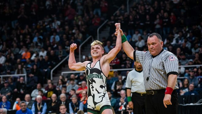 Minisink Valley wrestler Zack Ryder celebrates his win over Syosset's George Oroudjov during the NYSPHSAA state wrestling championships at the Times Union Center in Albany, NY on Saturday, February 29th, 2020. Ryder took home the championship for his 126 pound weight division. KELLY MARSH/FOR THE TIMES HERALD-RECORD