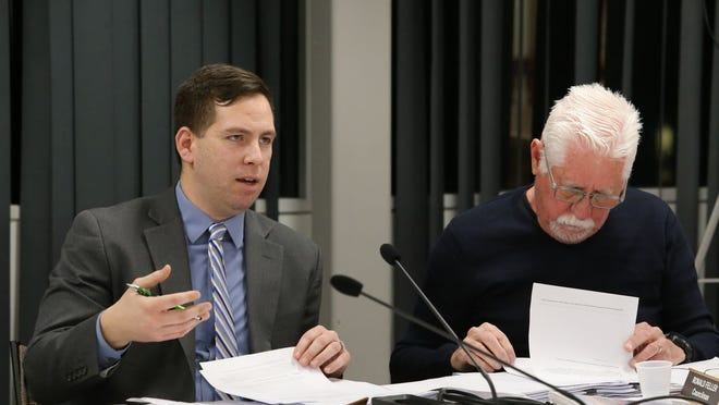 Town of Montgomery Supervisor Brian Maher, left, discusses the language of the proposed building moratorium with Town Board members in January. The board unanimously passed the moratorium on Thursday.