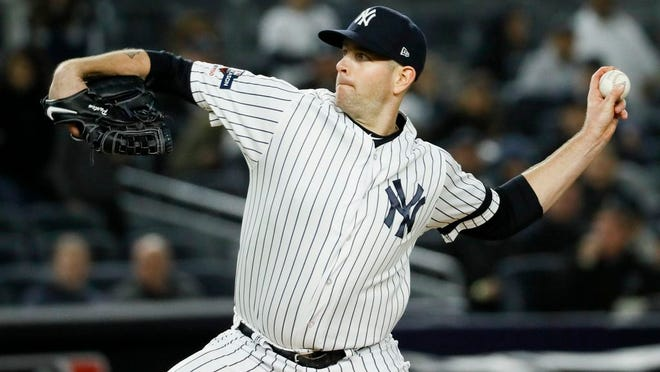 New York Yankees starting pitcher James Paxton throws against the Houston Astros during the first inning in Game 5 of baseball's American League Championship Series Friday, Oct. 18, 2019, in New York.