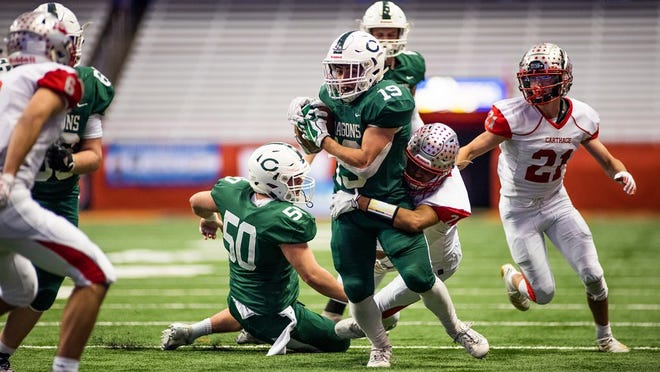 Football will have a tough time meeting criteria to return for fall 2020. Pictured here is the 2019 Class A state title game between Cornwall (green) and Carthage. KELLY MARSH/FOR THE TIMES HERALD-RECORD