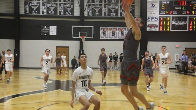 Sulphur's Weston Arms flies to the basket for a dunk as Lone Grove's Aiden Hale watches on during the second half Tuesday night at Lone Grove.