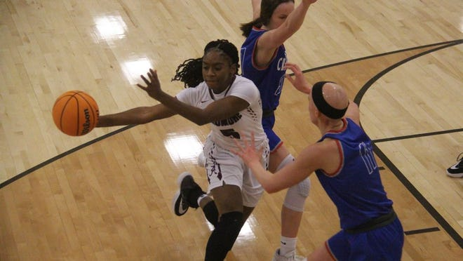Ardmore's Miyah McGee looks to make a pass in the lane while driving during the first half Saturday afternoon against Christian Heritage at the Ardmore High School Gymnasium.
