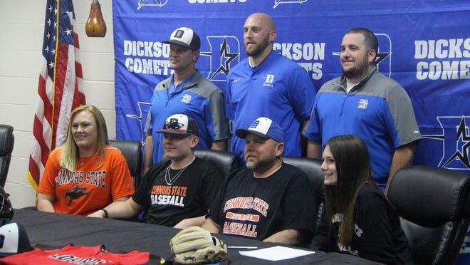 Dickson's Rusty Beard smiles alongside members of his family and members of the Dickson High School baseball and football coaching staff last Wednesday afternoon after signing his National Letter of Intent to play college baseball for Connors State College in Muskogee.