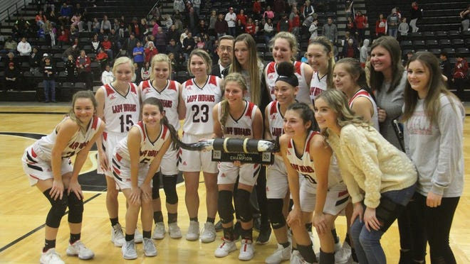 Members of the Plainview Lady Indians basketball team pose together after winning the Longhorn Invitational tournament Saturday night against Cache at the Gary Scott Center in Lone Grove.
