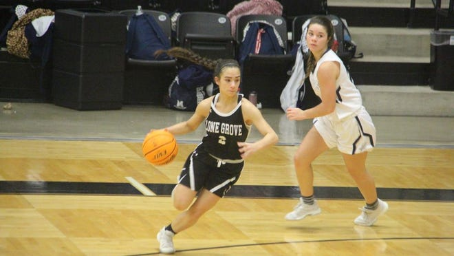 Lone Grove's Maili Coe drives to the basket during the second half Saturday afternoon against Marlow in the third place game of the Longhorn Invitational tournament at the Gary Scott Center.