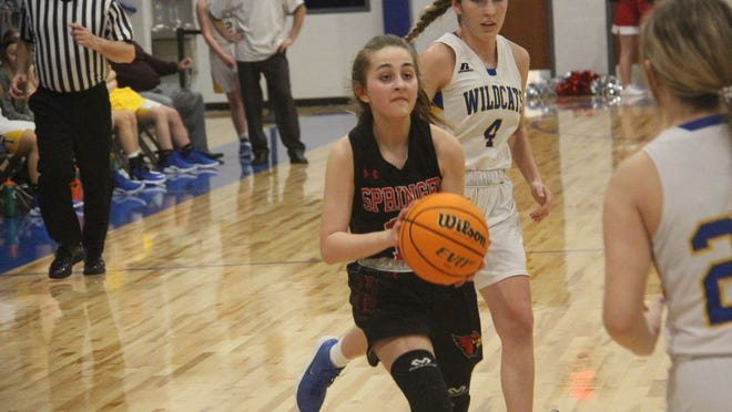 Springer's Cadence Shelley readies to take a shot in transition during the second half Monday night against Thackerville at the new Thackerville Gymnasium.