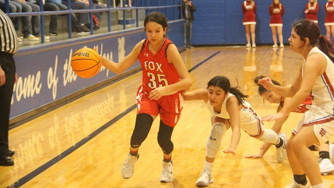 Fox's Maci Rodriguez dribbles with the ball during the second half Friday night against Wynnewood in the semifinals of the Bulldog Bash tournament in Healdton.