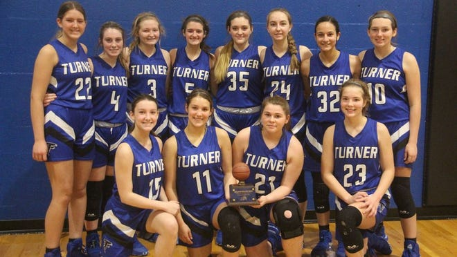Members of the Turner Lady Falcons varsity basketball team pose together for a team photo after winning the consolation championship at the 11th annual Bulldog Bash tournament on Saturday in Healdton.