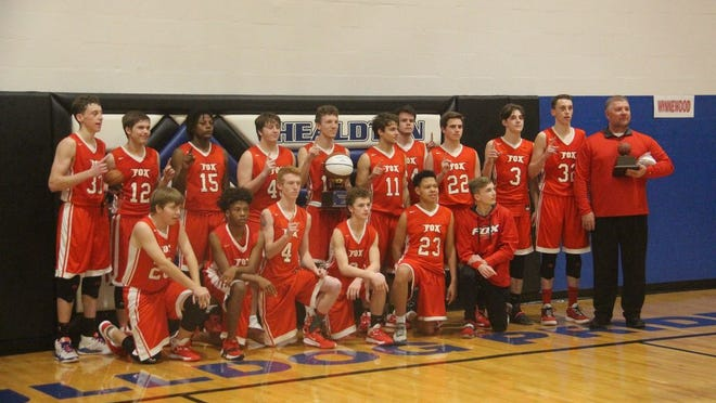 Members of the Fox Foxes basketball team pose together for a team photo Saturday night after winning the 11th annual Bulldog Bash tournament at Healdton.
