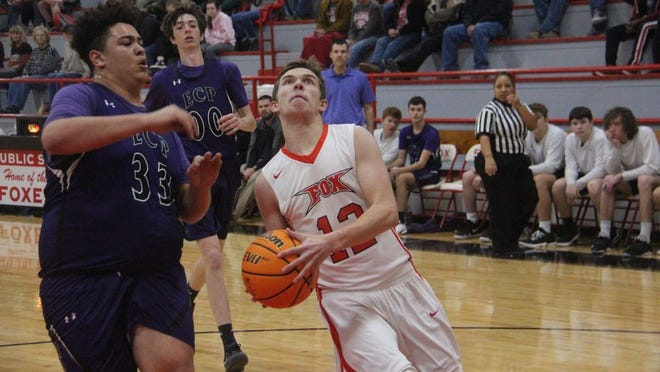 Fox's Matthew Bowerman drives to the basket on a fast break during the first half Monday night against Elmore City-Pernell at the Fox Den.