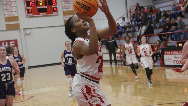 Fox's Jada Newhouse goes up for a layup in transition during the first half Monday night against Elmore City-Pernell at the Fox Den.