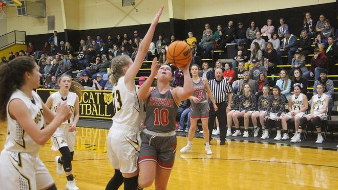 Sulphur's Meredith Jones puts up a shot in the lane as Madill's Braylee Schneider defends during the first half Tuesday night at Wildcat Fieldhouse.