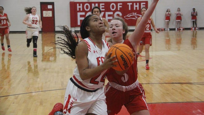 Fox's Jada Newhouse pushes her way to the basket in transition during the first half Monday night against Temple at the Fox Den.