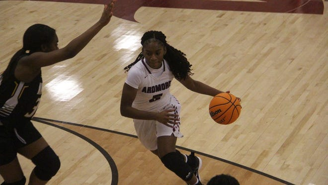 Ardmore's Miyah McGee drives to the basket during the first half Friday night against Lawton MacArthur at the Ardmore High School Gymnasium.