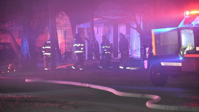 A house at 415 W. 10th Street caught fire shortly after midnight; investigation is underway.