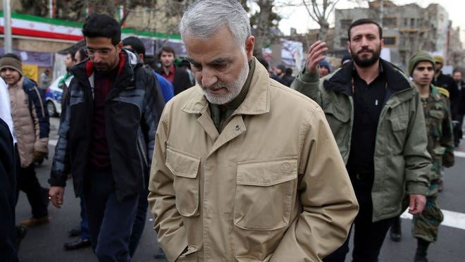 In this file photo, the commander of the Iranian Revolutionary Guard's Quds Force, General Qassem Soleimani, attends celebrations marking the 37th anniversary of the Islamic revolution on February 11, 2016 in Tehran. The airstrike killed Abu Mahdi al-Mohandes, the deputy head of Iraq's Hashd al-Shaabi militia, and Qassem Soleimani, the popular commander of Iran's elite Quds Force.