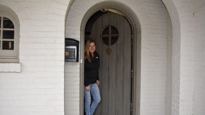 Phyllis Bolt stands just inside her doorway Thursday as she did earlier in the week when someone peddling candy rang her doorbell.