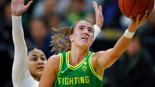 Oregon guard Sabrina Ionescu, front, drives to the rim for a basket past Colorado guard Lesila Finau late in the first half of an NCAA college basketball game Saturday, Feb. 1, 2020, in Boulder, Colo.
