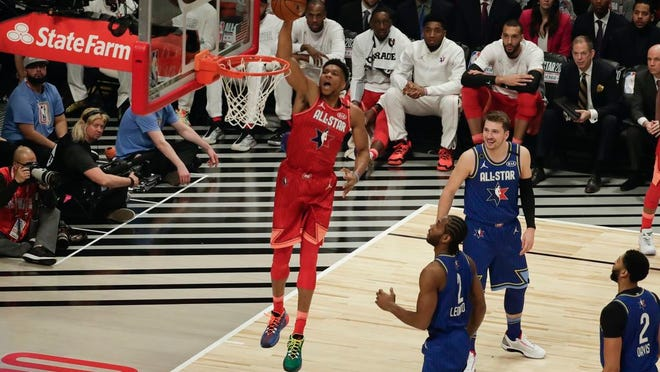 Giannis Antetokounmpo of the Milwaukee Bucks dunks during the first half of the NBA All-Star basketball game Sunday, Feb. 16, 2020, in Chicago.