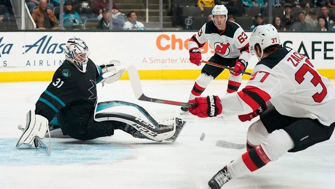 San Jose Sharks goaltender Martin Jones (31) blocks a shot by New Jersey Devils center Pavel Zacha (37) during the second period of an NHL hockey game Thursday, Feb. 27, 2020, in San Jose, Calif.