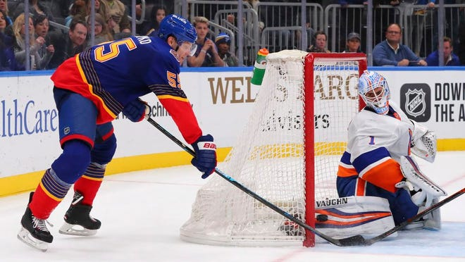 St. Louis Blues defenseman Colton Parayko (55) scores the winning goal against New York Islanders goaltender Thomas Greiss (1), of Germany, during overtime of an NHL hockey game Thursday, Feb. 27, 2020, in St. Louis.