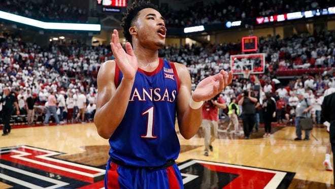 Kansas' Devon Dotson (1) celebrates after an NCAA college basketball game against Texas Tech, Saturday, March 7, 2020, in Lubbock, Texas.