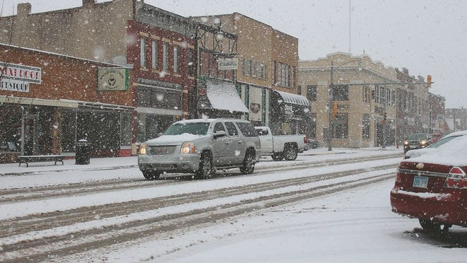 Large flakes of snow swirl from the sky in downtown Pratt at about 1 p.m. on Tuesday, January 28. While up to 12 inches of snow were forecast for the area initially, actual totals may stay in the 3 inch range for the area, according to National Weather Service forecasters in Dodge City.