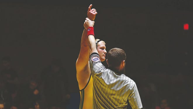 Hunter Huber raises his hand in triumph at the Clearwater Wrestling Tournament last week, where he won first place in his division.