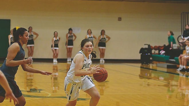 Pratt High School sophomore Lexi Walker dribbles past Greenback opponents on the court during a close game last week.