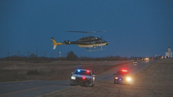 A LifeSave helicopter lands in the median on east Highway 54 to transport a crash victim to Wesley Medical Center in Wichita. The Sunday crash claimed the life of a Dodge City man and sent two other Dodge City residents to Wesley.