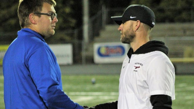 Clay Carlton (left) shakes hands with Weeping Water Coach, Joel Haveman.  Lourdes defeated the Indians 52-22 on October 24, 2019.