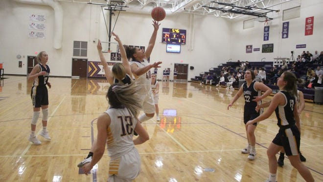 Patricia Trice goes up for a shot against Raymond Central on Thursday night.