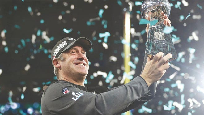 Philadelphia Eagles head coach Doug Pederson hoists up the Lombardi Trophy  after Super Bowl LII.