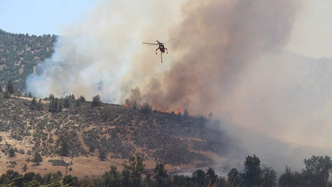 Firefighters worked to contain the Klamathon Fire in July of 2018, which destroyed part of the town of Hornbrook and claimed a life.
