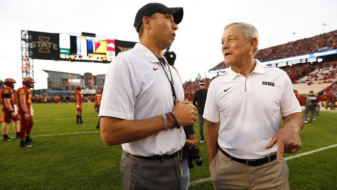 Iowa State head coach Matt Campbell talks with Iowa head coach Kirk Ferentz, right, before an NCAA college football game Sept. 14 in Ames.